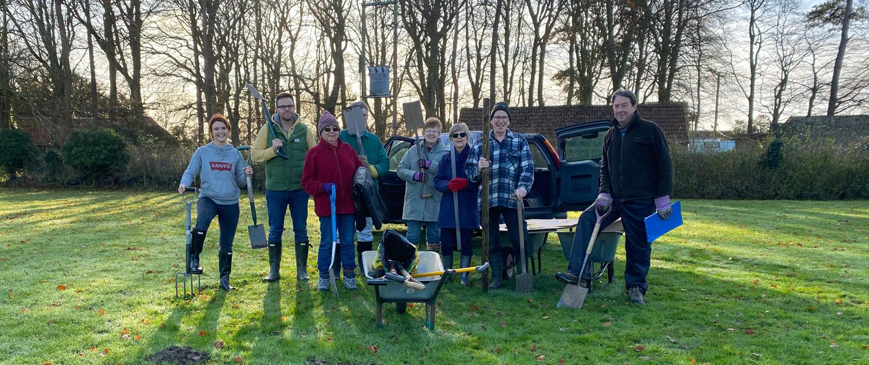 Volunteers tree planting at Lympne Village Playing Field